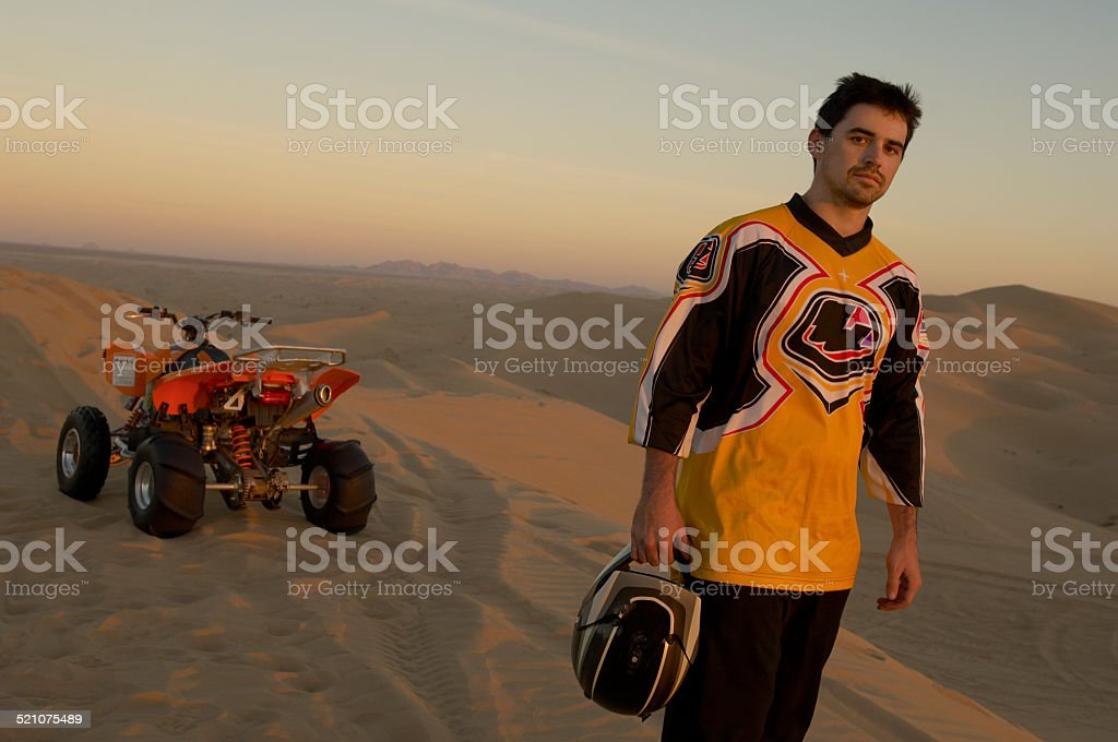 Man Riding Quadbike In Desert stock photo