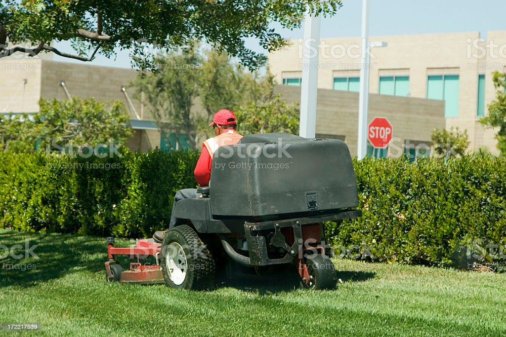 Man riding sit on lawnmower mowing grass royalty-free stock photo