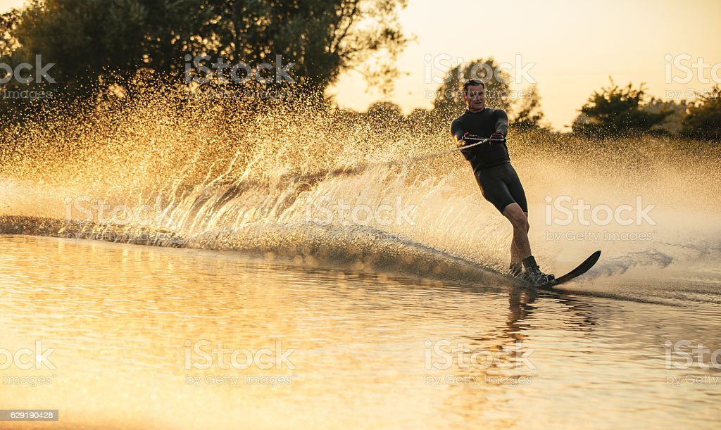 Man riding wakeboard in a lake stock photo