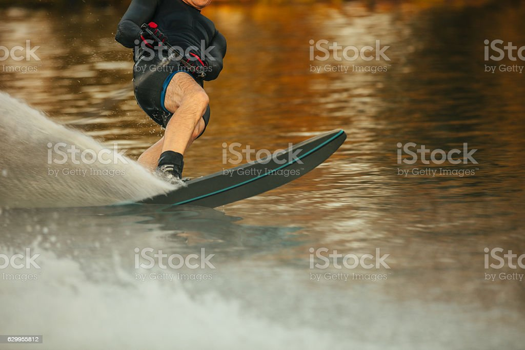Man riding wakeboard on a lake stock photo