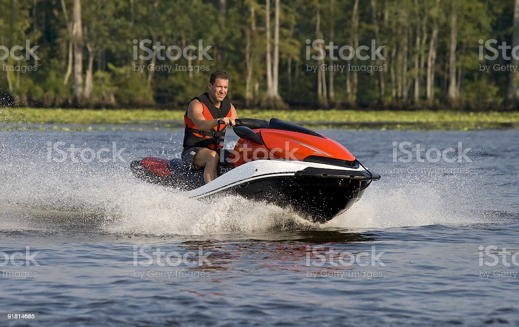 Man riding wave runner in river royalty-free stock photo