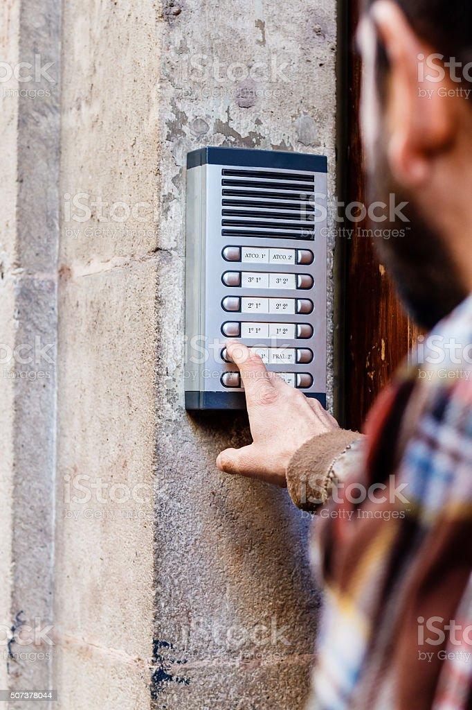 Man ringing the doorbell stock photo