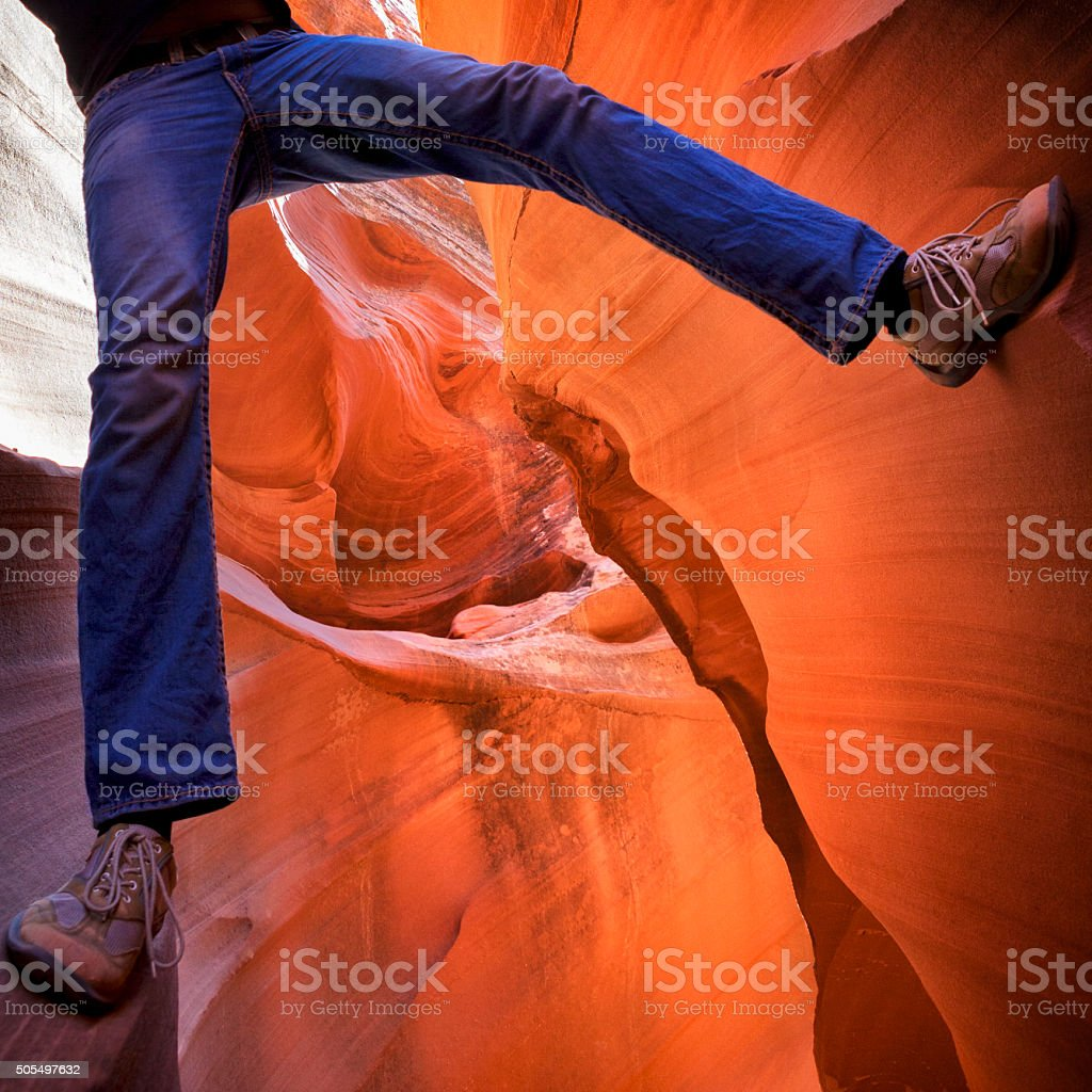 Man Rock Climbing at Antelope Canyon in Arizona, USA stock photo