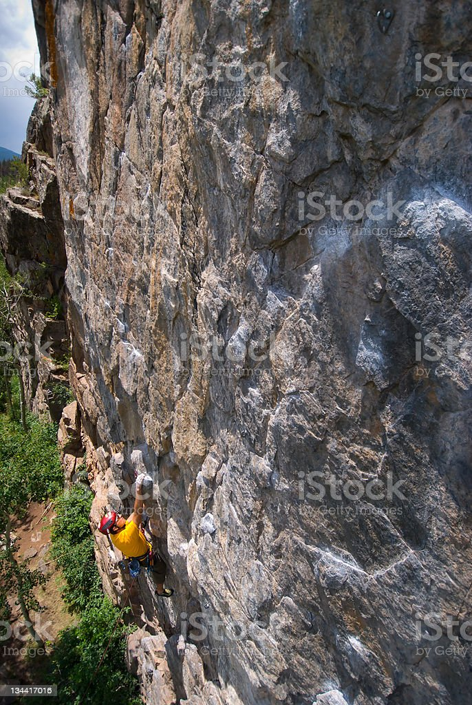 Man Rock Climbing in Rugged Canyon stock photo