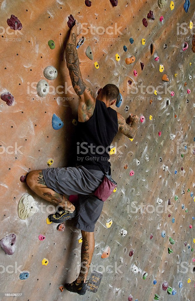 Man Rock Climbing Indoors royalty-free stock photo