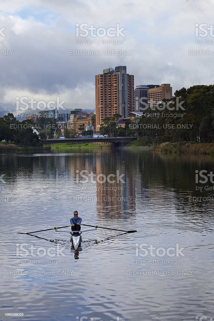 Man rowing a single scull in Adelaide stock photo