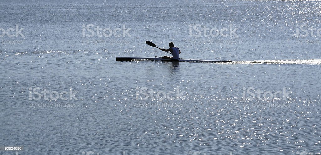 Man rowing at full speed in a kuala stock photo