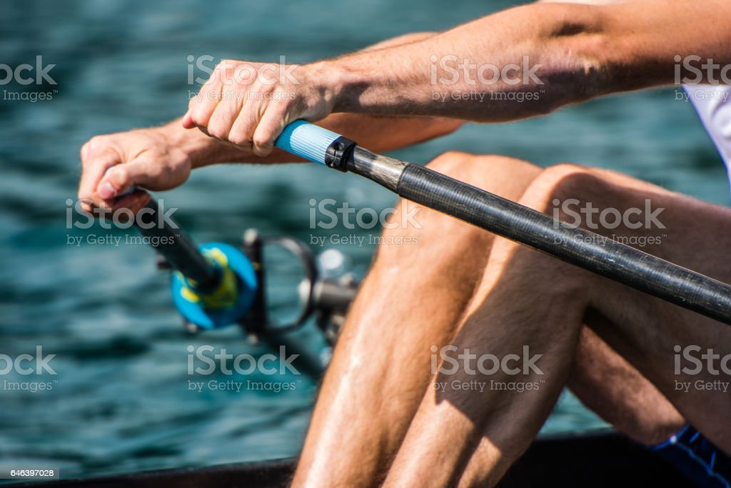 Man rowing boat stock photo