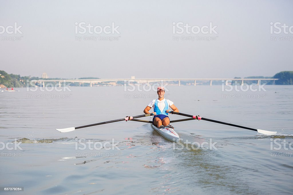 Man rowing on the river close up shot stock photo