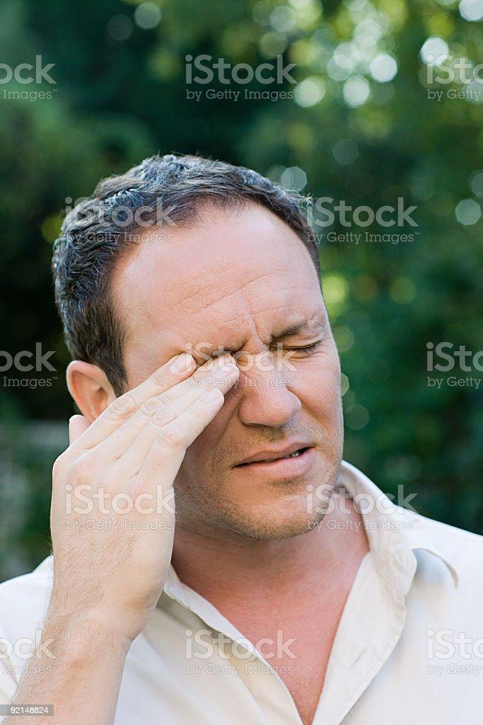 Man rubbing eye stock photo