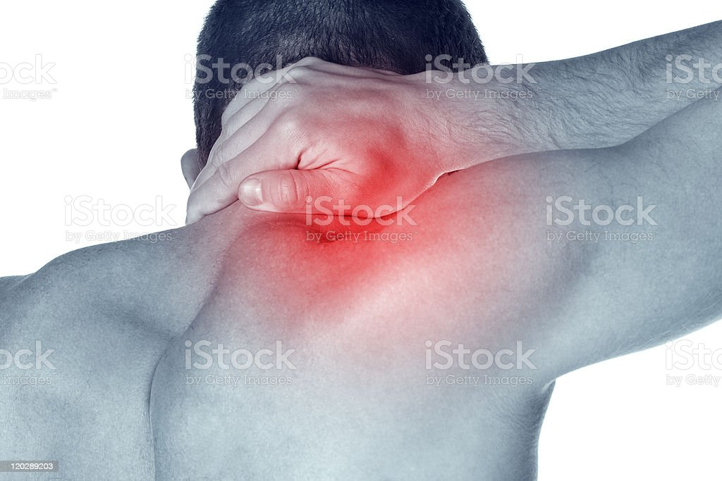 Man rubbing his neck where a red area signifies pain stock photo