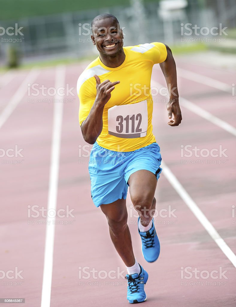 Man running a 100 mts stock photo