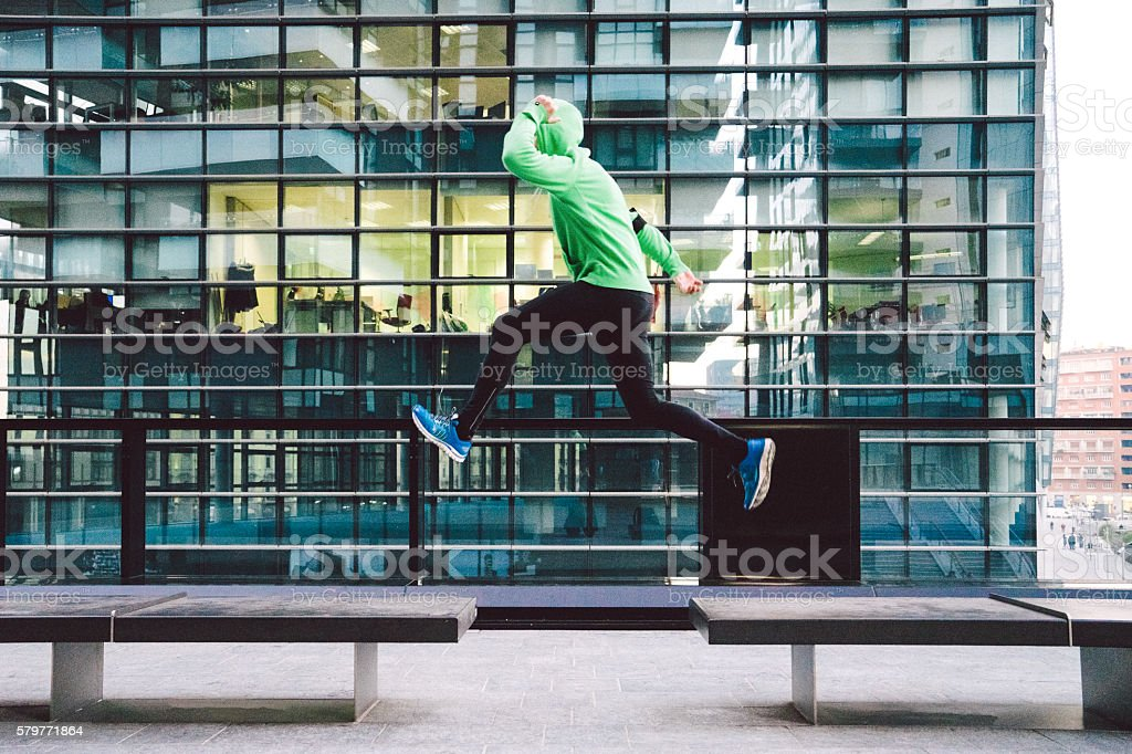 Man Running And Jumping, Outdoors Sport Training stock photo