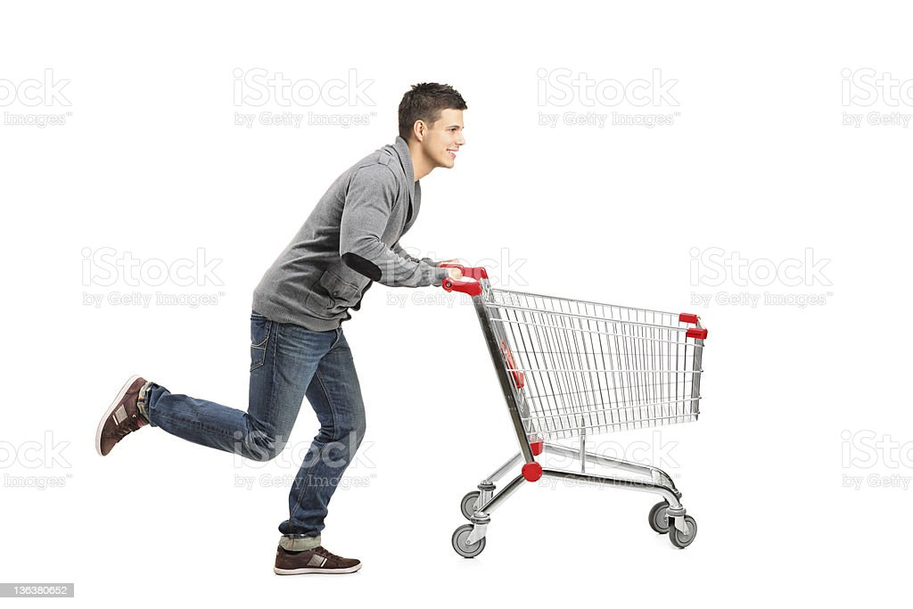 Man running and pushing an empty cart stock photo