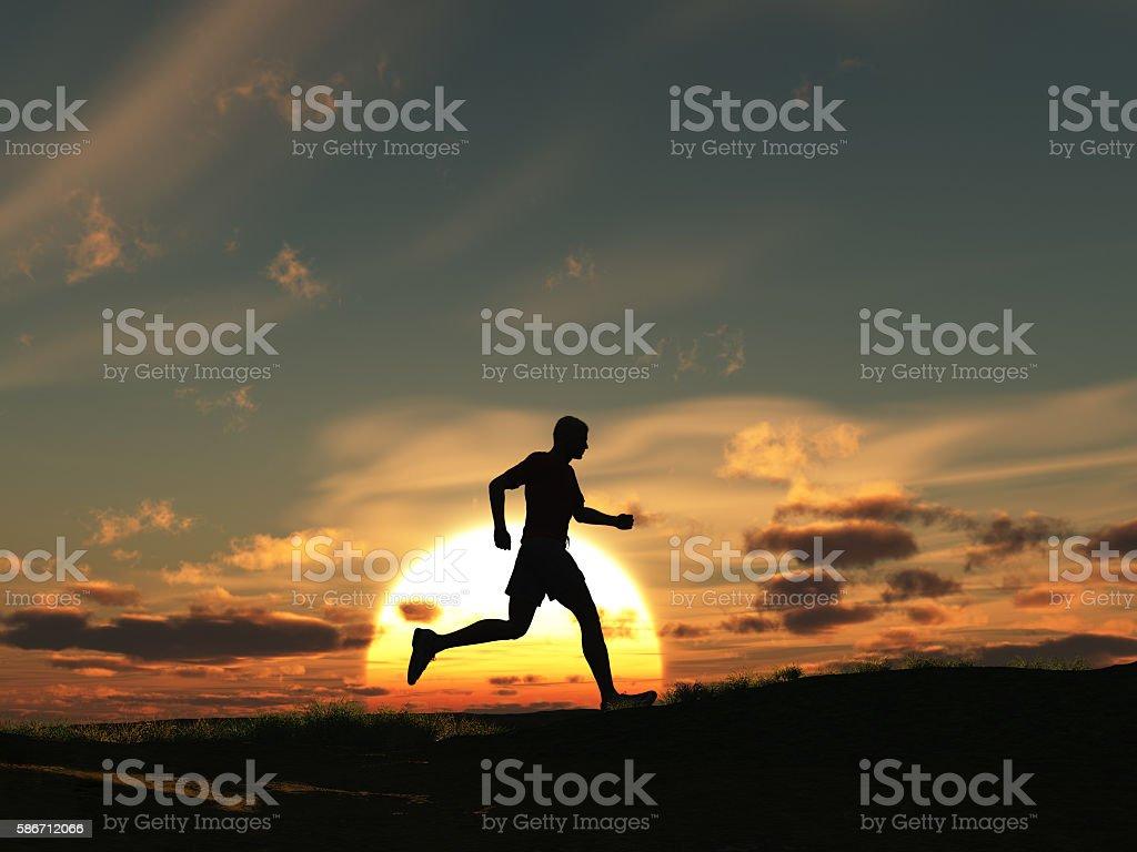 Man running at dawn stock photo