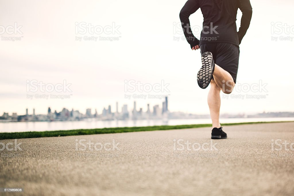 Man Running At Seattle Beach stock photo
