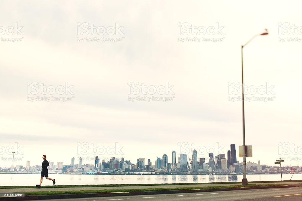 Man Running At Seattle Beach stock photo