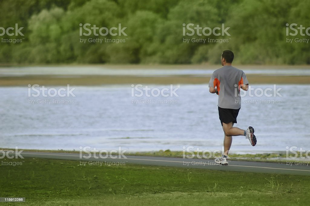 Man running at the park stock photo