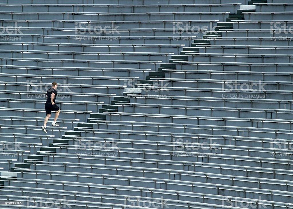 man running bleachers royalty-free stock photo