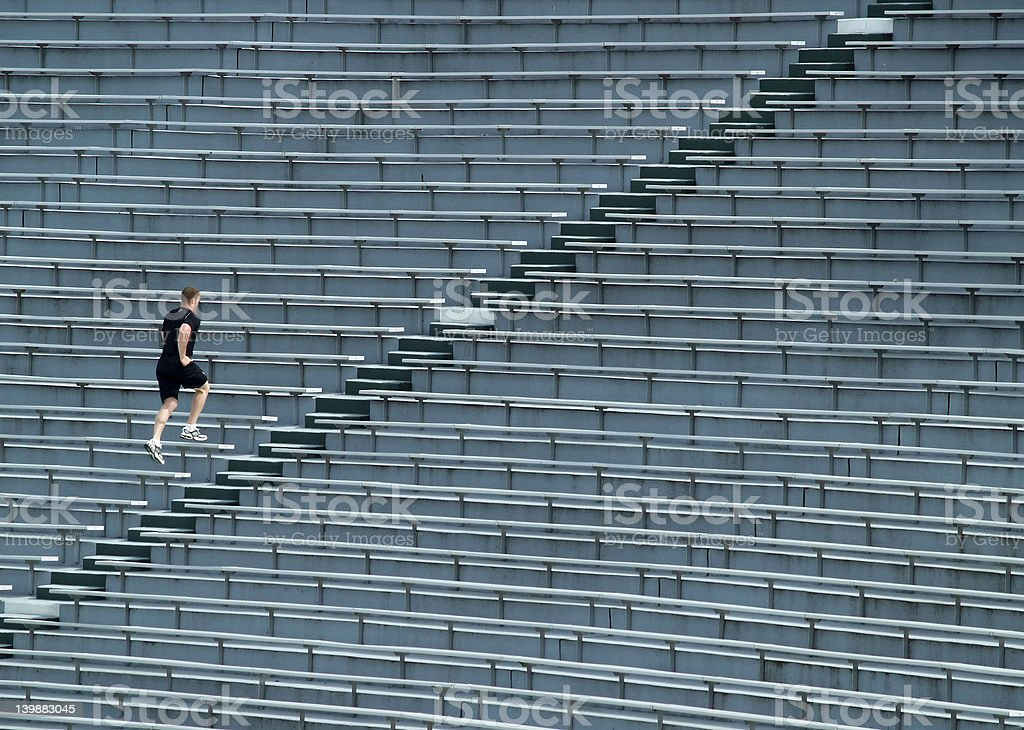man running bleachers stock photo