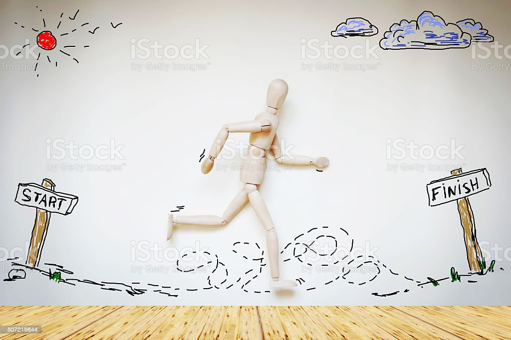 Man running from start to finish stock photo