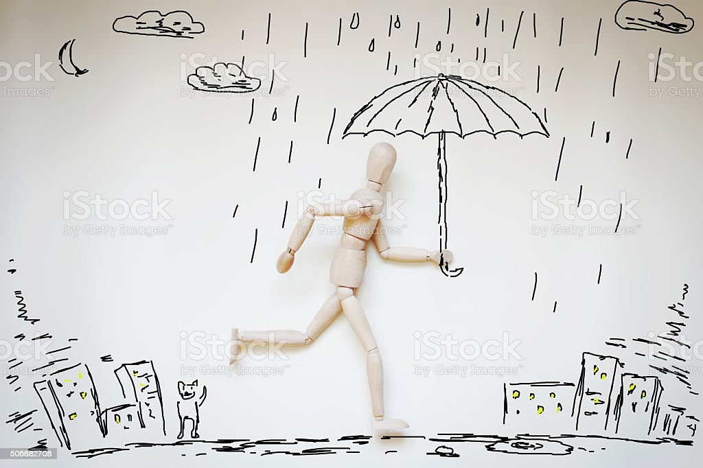 Man running home under umbrells in raining stock photo