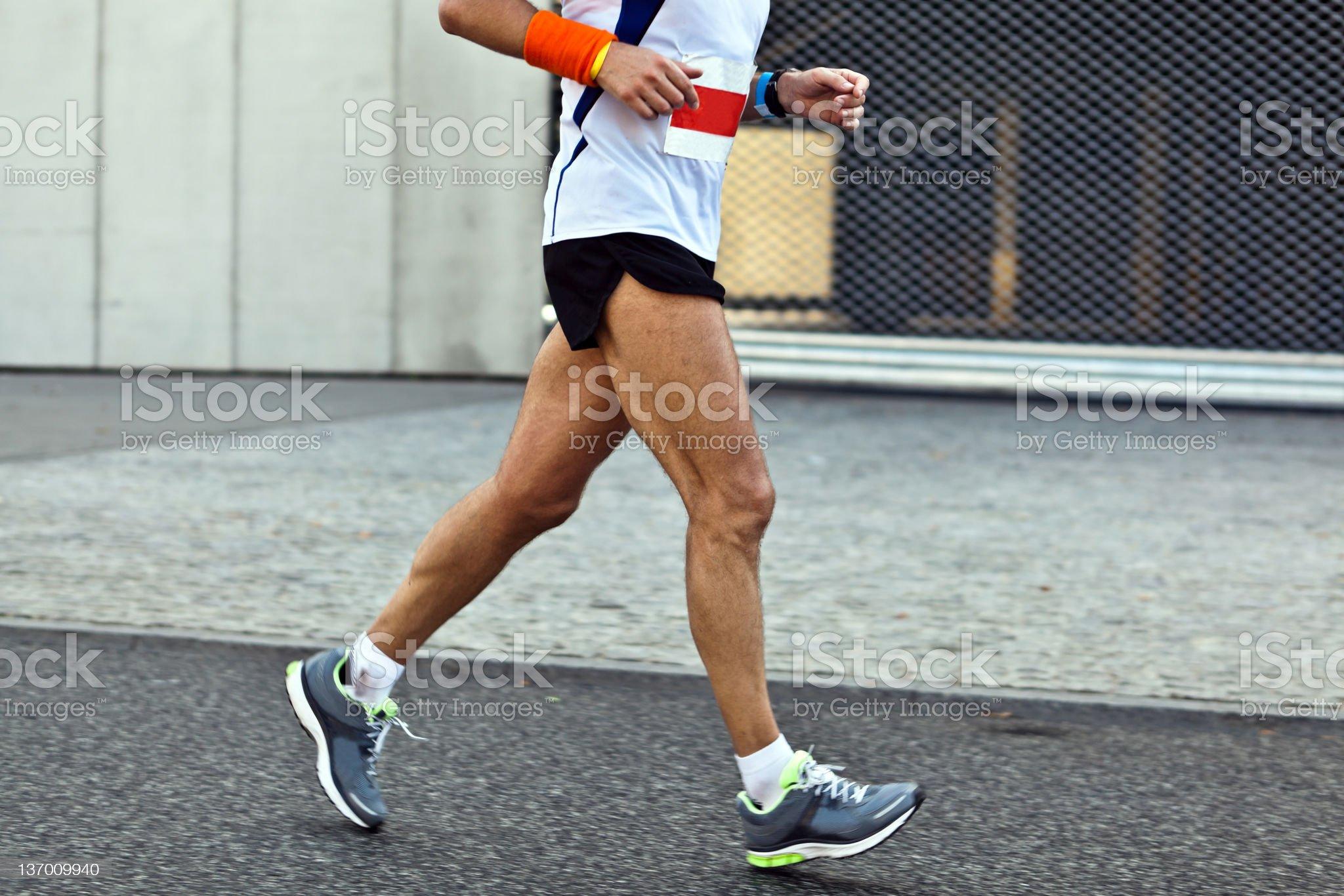 Man running in city marathon, blurred motion royalty-free stock photo
