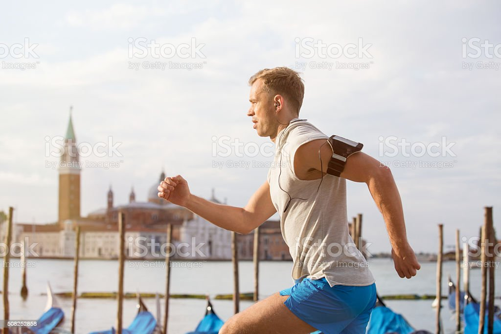 Man running in early morning stock photo