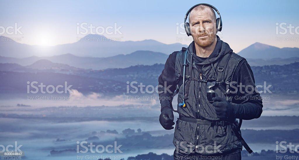 Man running in mountains at sunrise stock photo