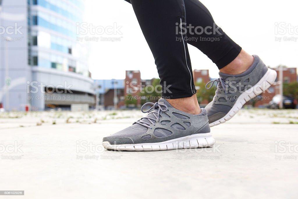 Man running in sneakers stock photo