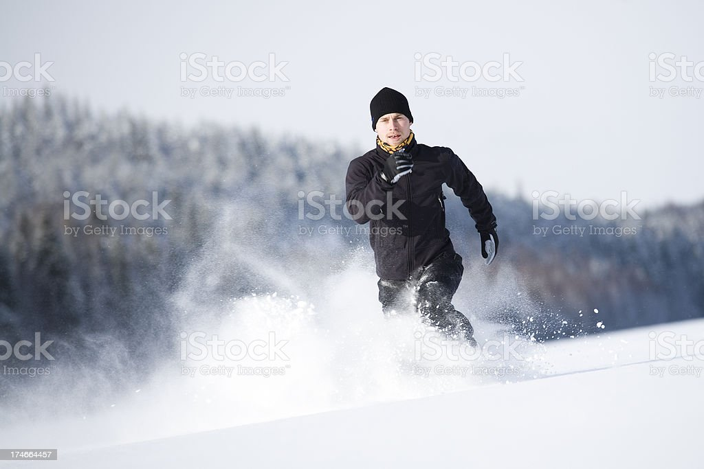man running in snow royalty-free stock photo