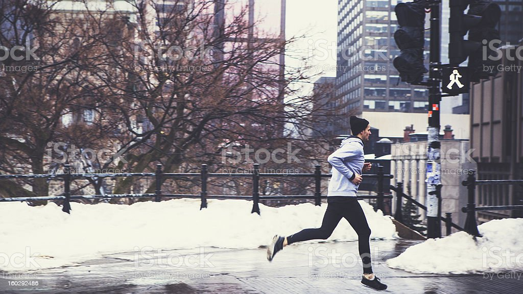 A man running in the winter snow royalty-free stock photo