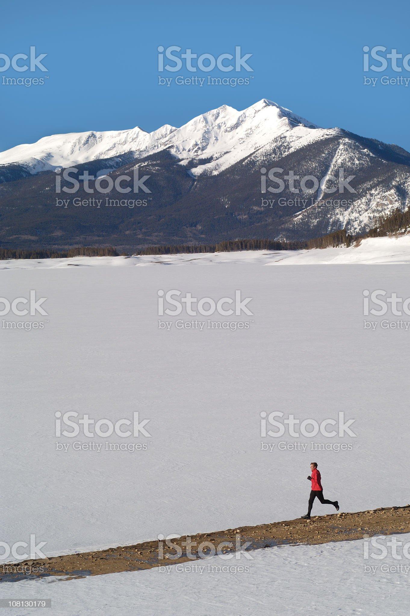 Man Running in Winter Mountain Range royalty-free stock photo