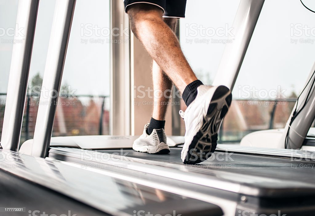 Man running on a treadmill stock photo