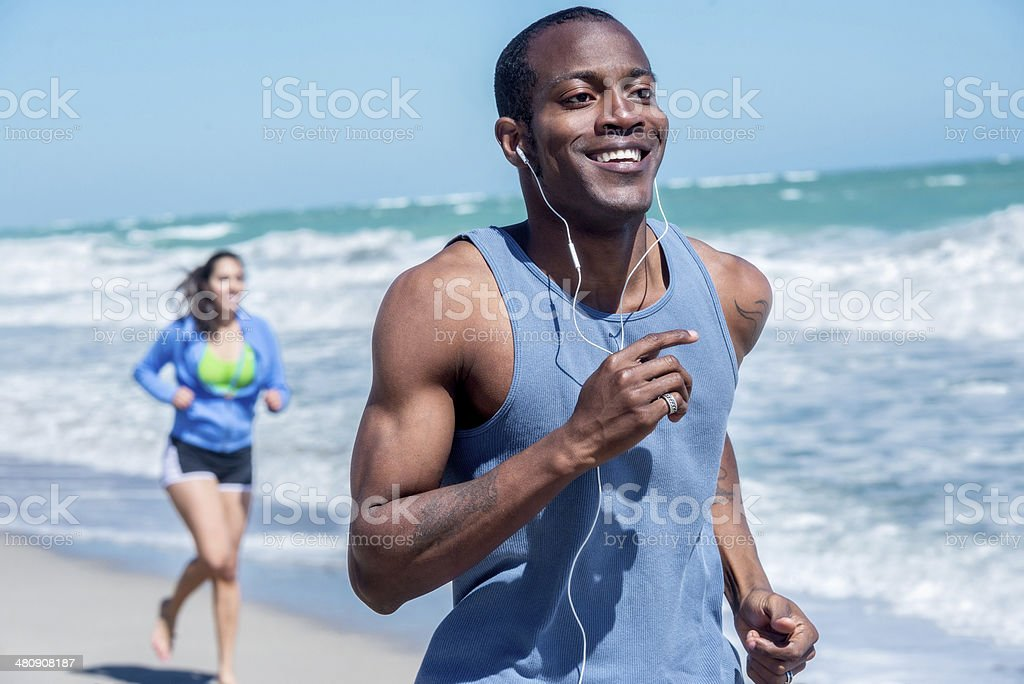Man running on a Vero Beach stock photo