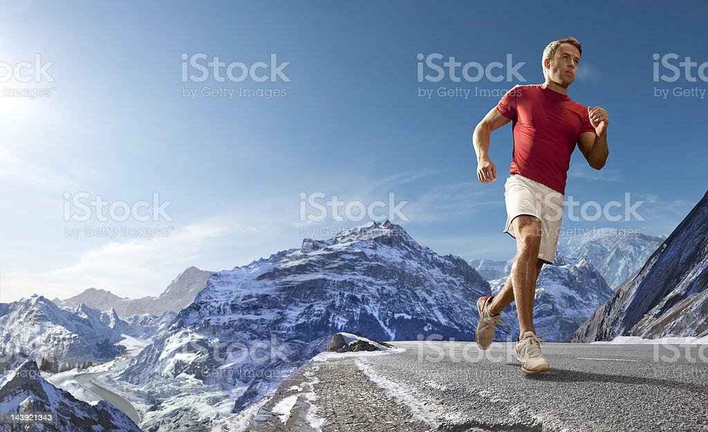 Man Running On Mountain Road royalty-free stock photo