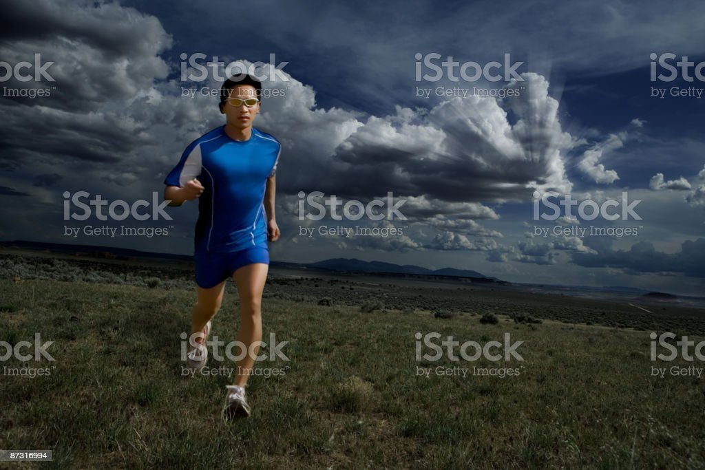 Man running on plain stock photo