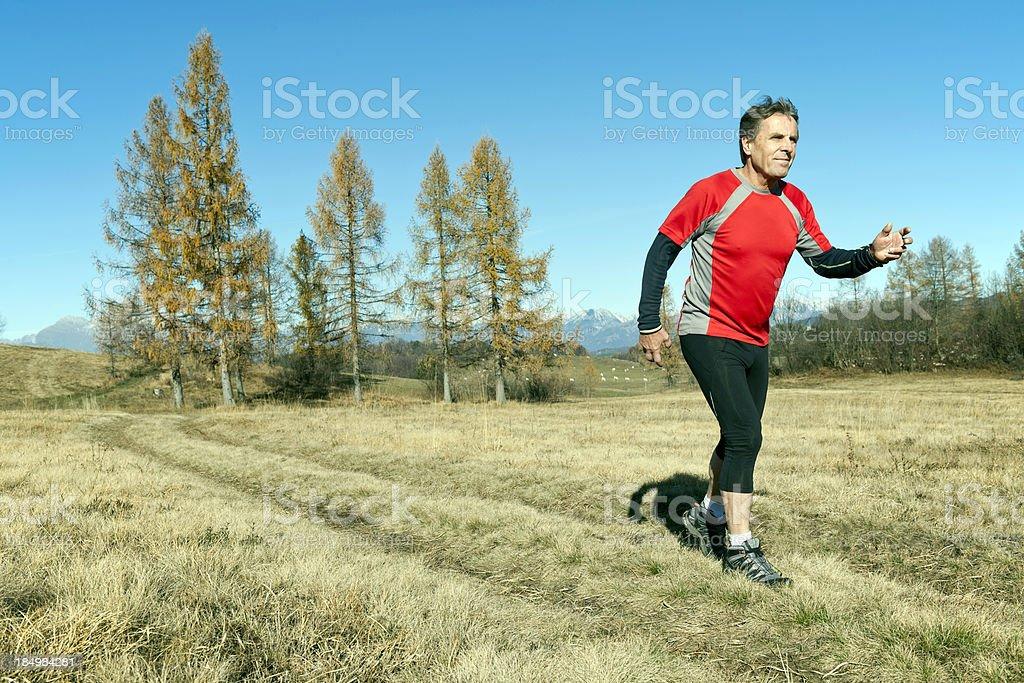 Man Running on Plateau Banjšice royalty-free stock photo