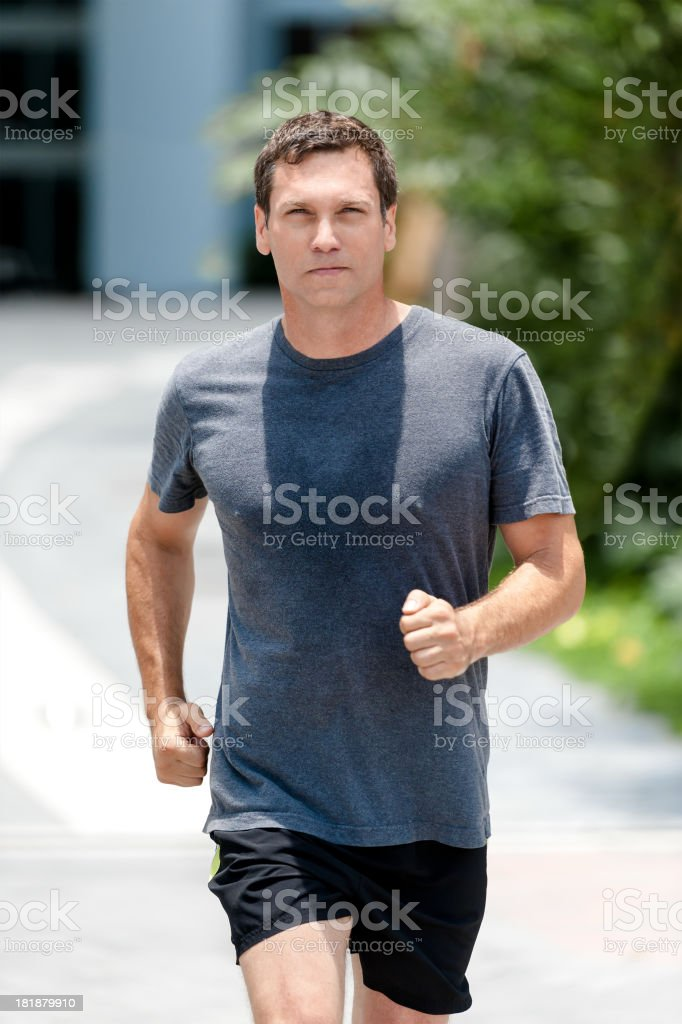 Man Running on Residential Street royalty-free stock photo