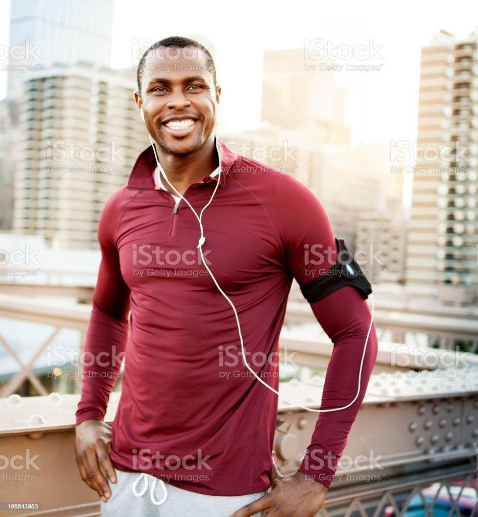 Man running on the brooklyn bridge stock photo