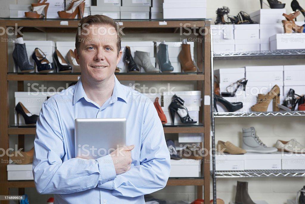 Man Running Online Shoe Business stock photo