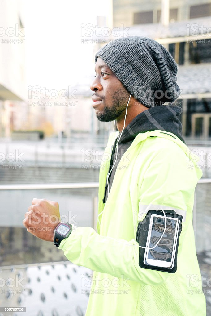 Man Running Outdoors In The Early Morning stock photo