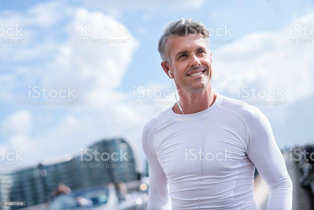 Man running outdoors stock photo