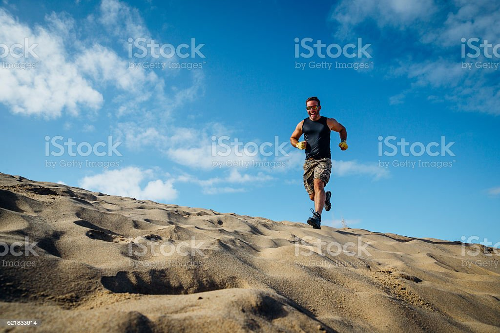 Man Running over Sand stock photo