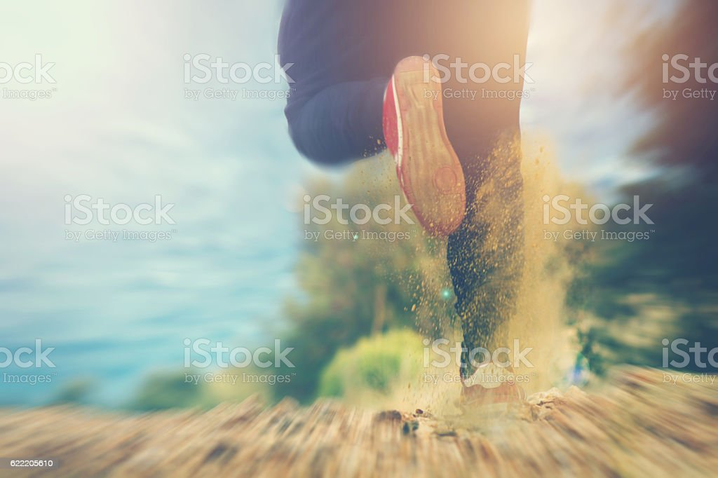 Man running through sea stock photo