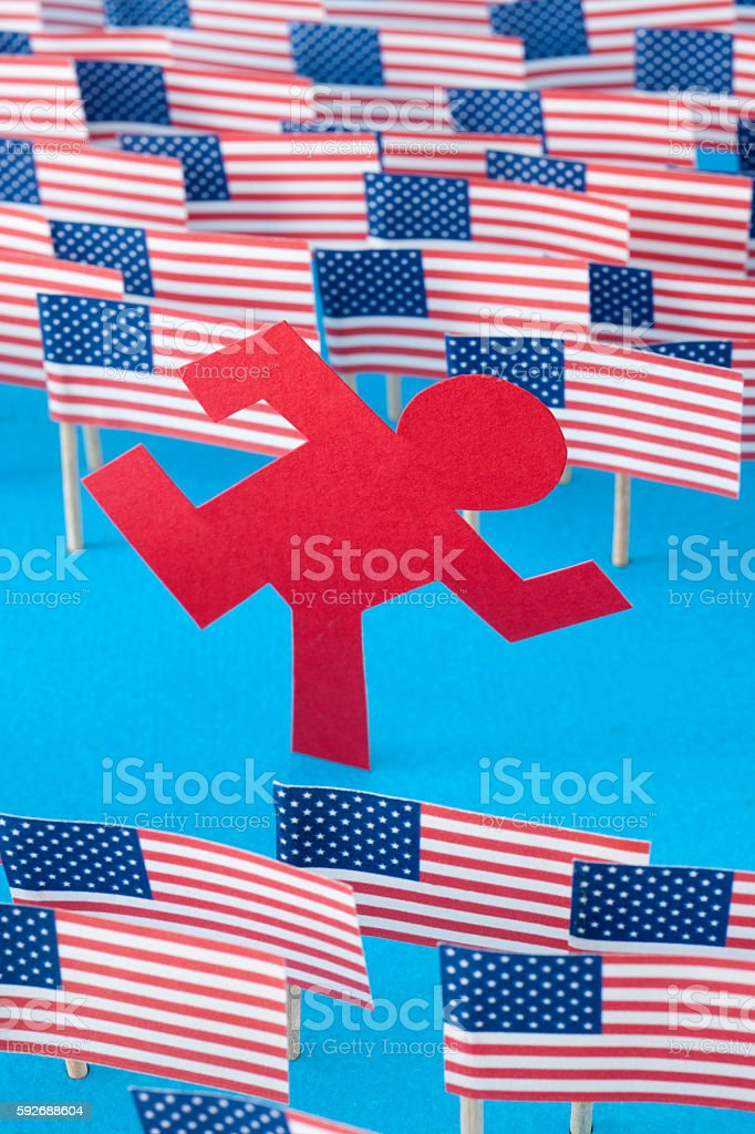 Man running through US flags stock photo