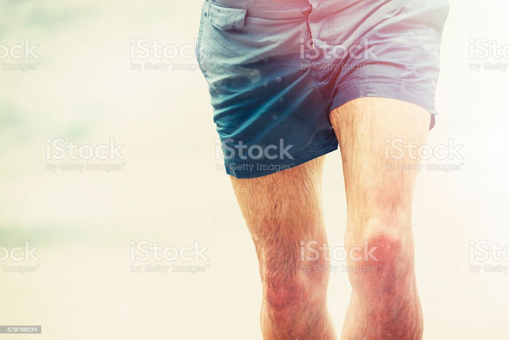 Man running up a Beach, Cornwall, holiday background. stock photo