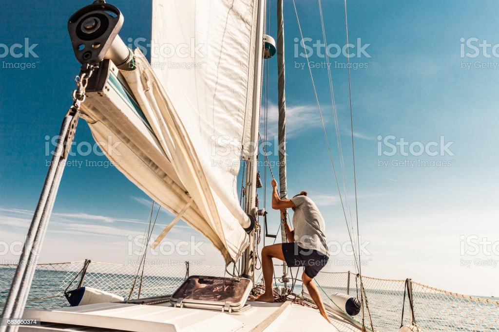 Man sailing and fishing during summer holidays stock photo