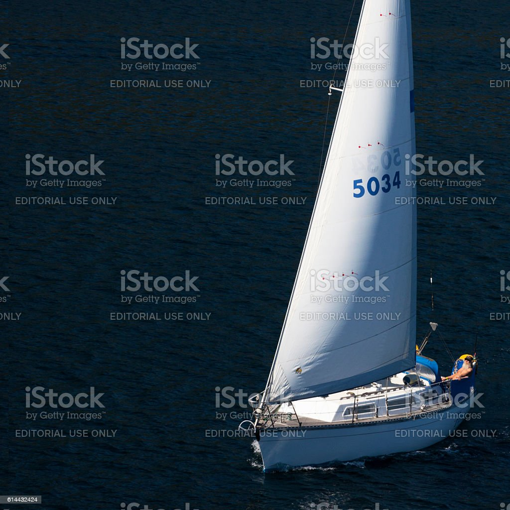 Man sailing on the Cook Strait in New Zealand stock photo