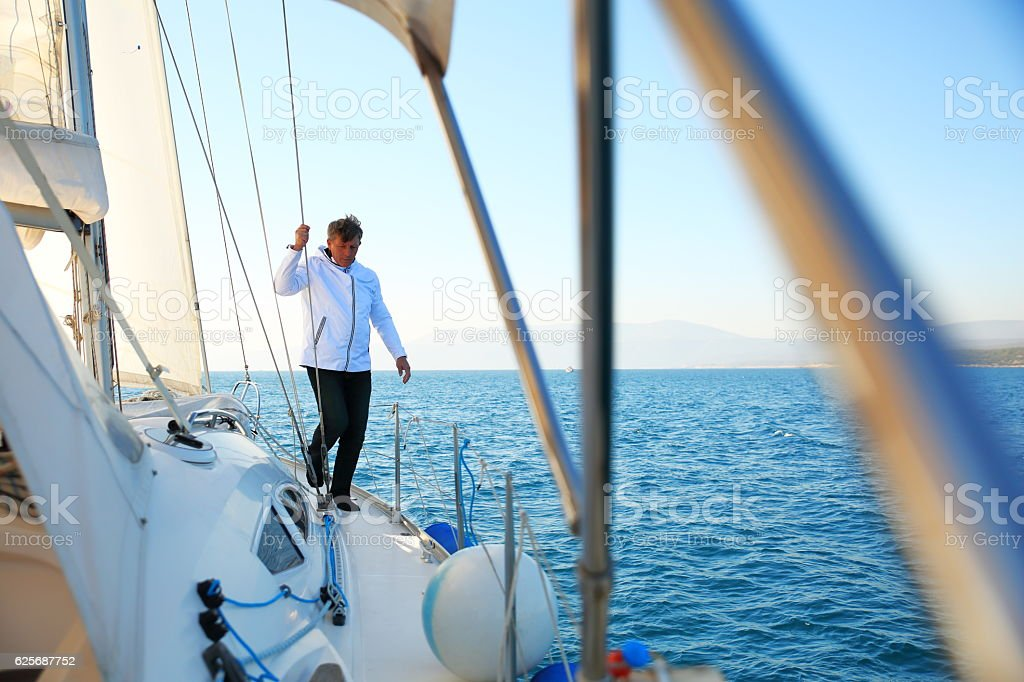 Man sailing stock photo